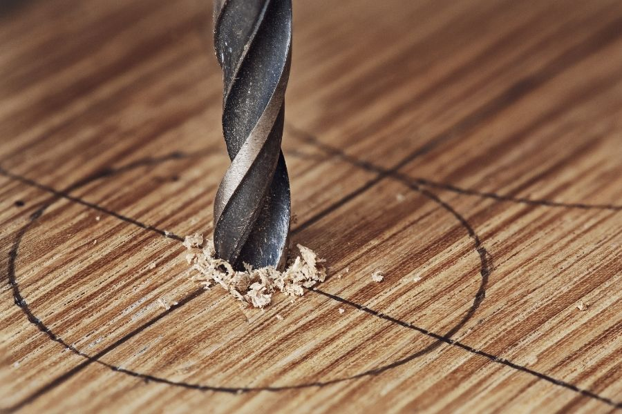 Drill a hole bigger than your drill bit